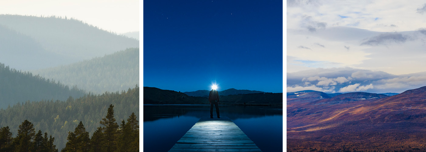 Forest landscape. A person is standing on a dock with a bulb. Autumn in mountain scenery.